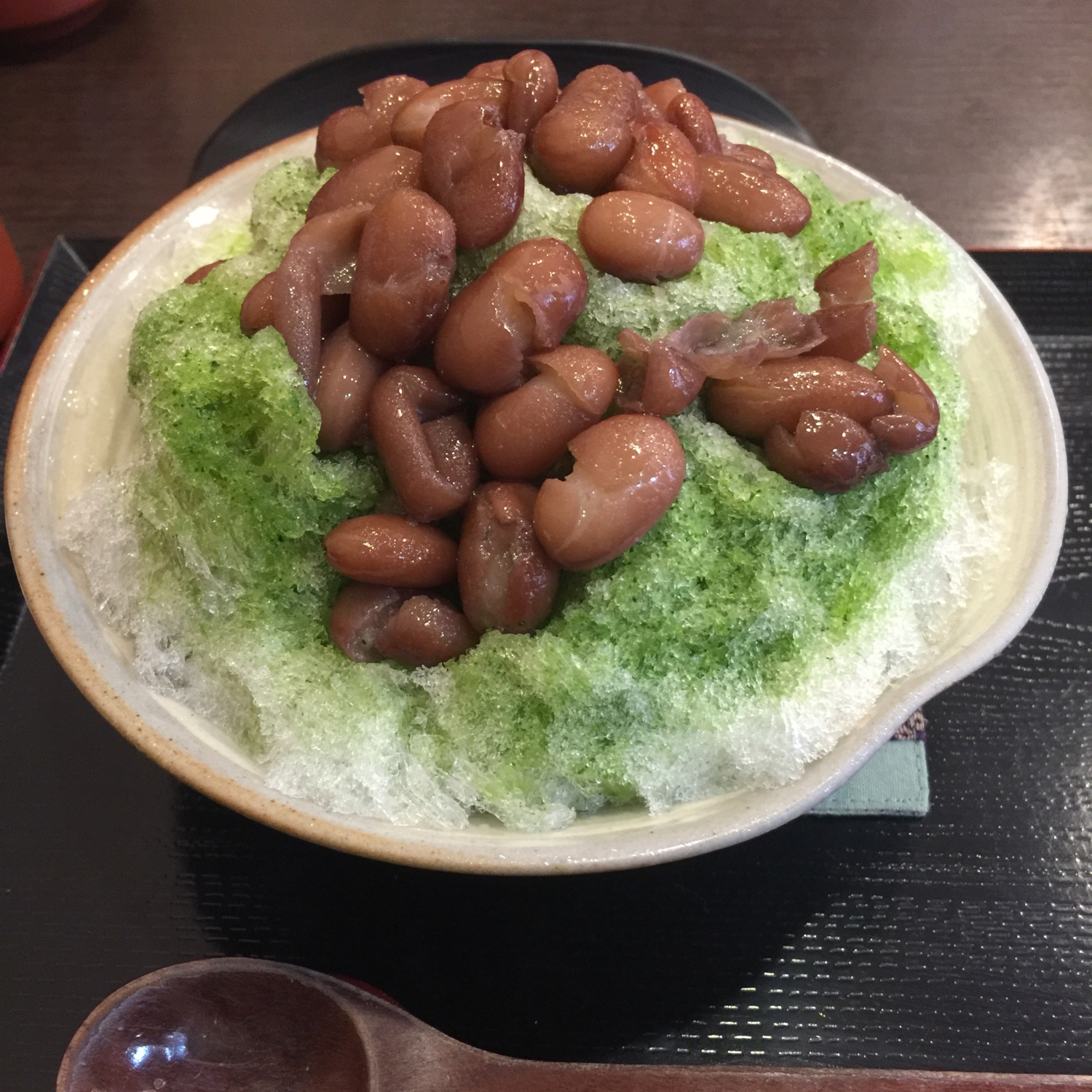 Uji bowl of shaved ice with boiled adzuki beans
